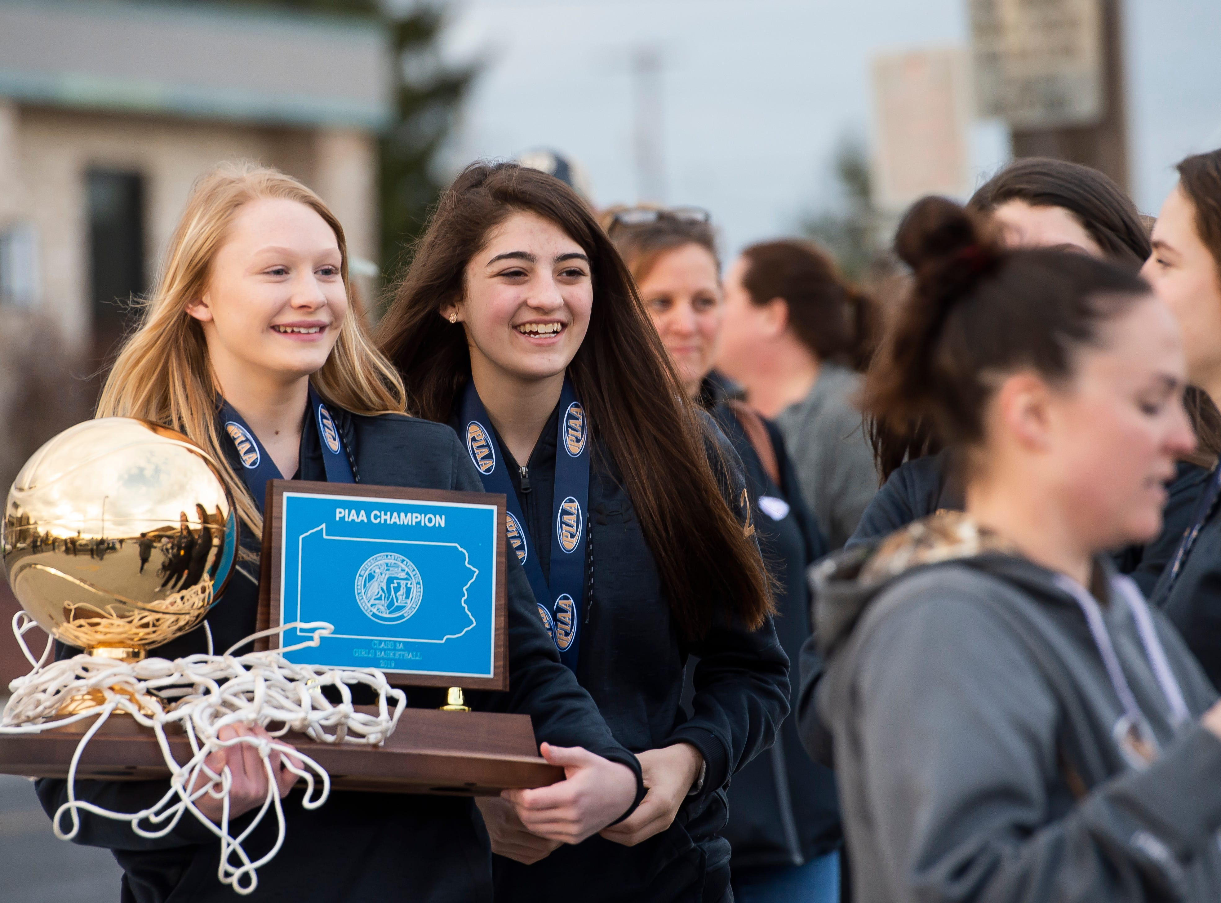 Delone Catholic's Brooke Lawyer (left) and Maddie Sieg smile following a parade in McSherrystown celebrating the Squirettes' PIAA championship on Thursday, March 28, 2019.