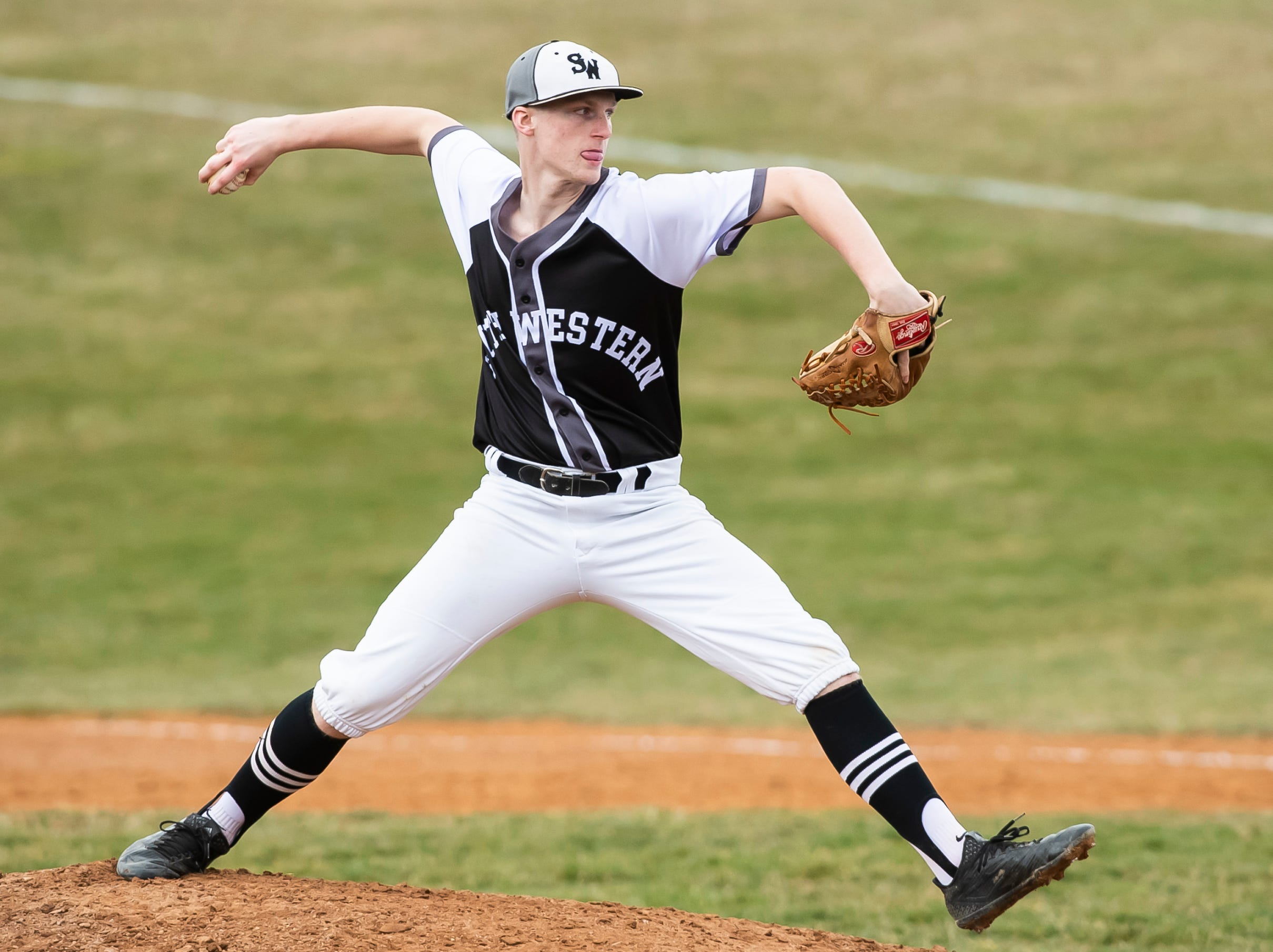 South Western's Aaron Hughes pitches against Carlisle in Hanover on Friday, March 29, 2019. The Mustangs won 11-9.