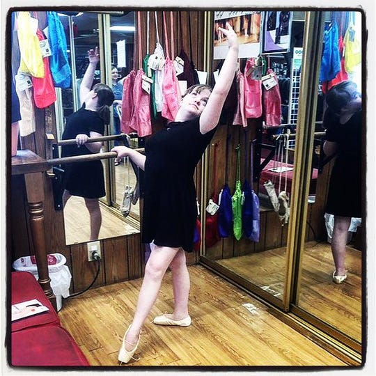 Sophie Stern picking out her pre-pointe shoes for ballet.