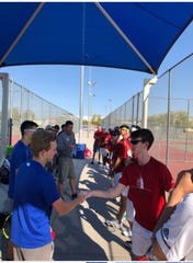Brophy Prep boys tennis players shakes hands with Chandler boys tennis teams after match on March 28, 2019.