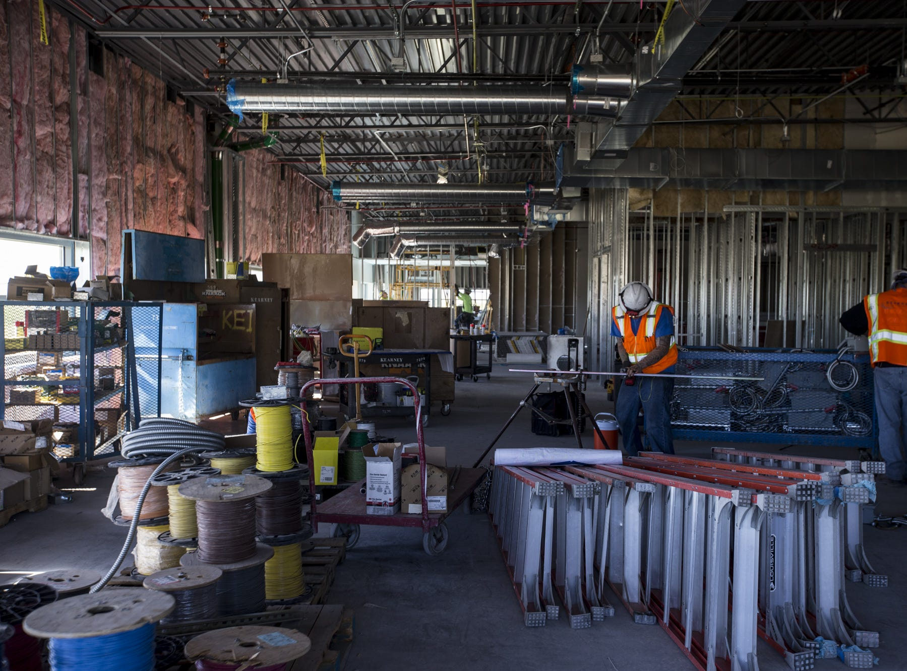 Construction crews work on administrative offices on Friday, March 29, 2019, at Mayo Clinic in Phoenix.