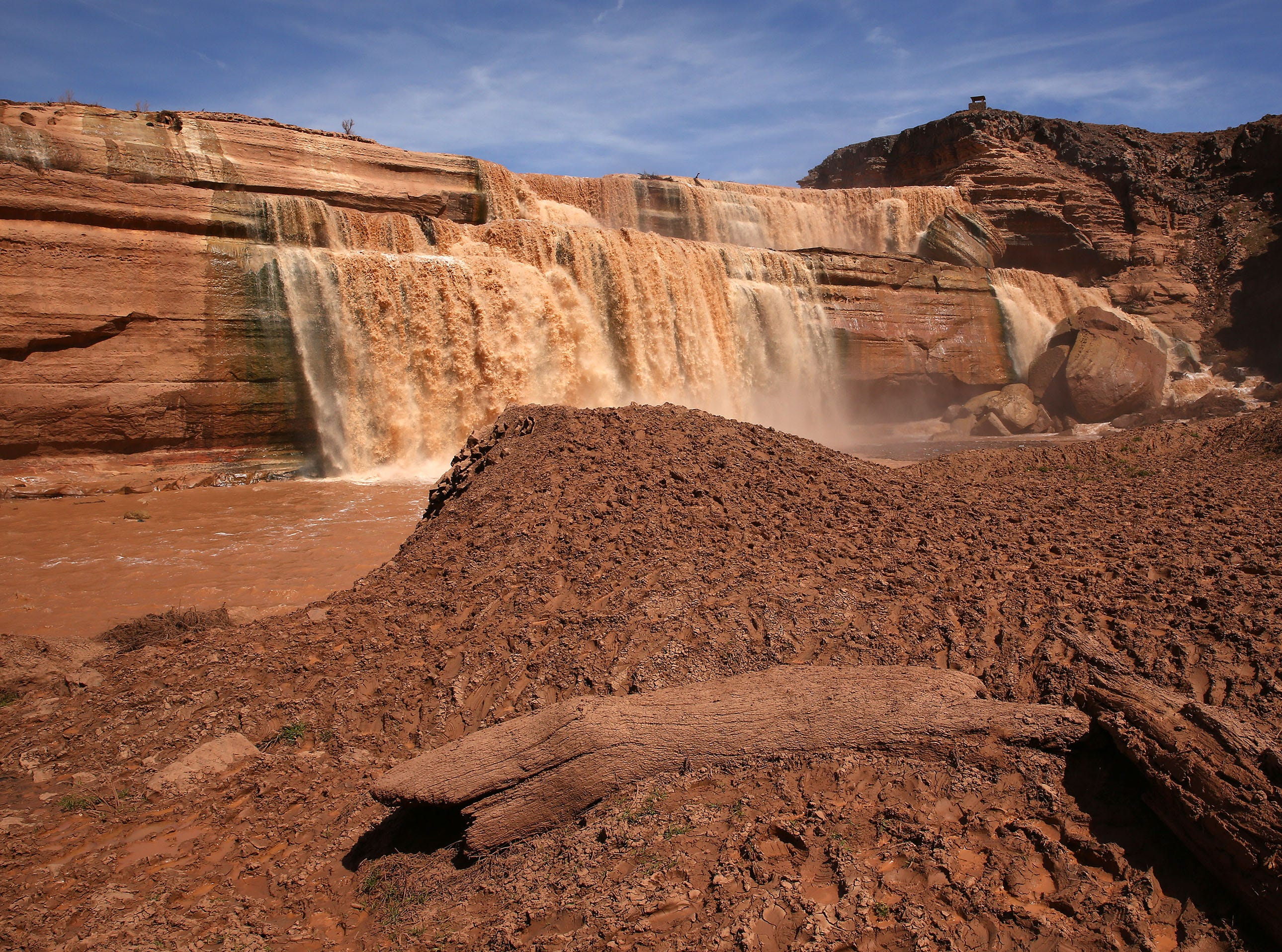 Grand Falls in the Painted Desert on the Navajo Nation on March 28, 2019, near Leupp, Arizona. Melted snow and rain travels down the Little Colorado River to the 185-foot fall a.k.a. Chocolate Falls. Grand Falls is 18 feet taller than Niagara Falls.