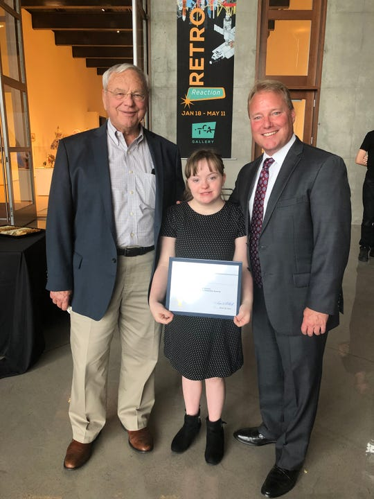 On March 26, Sophie Stern, 15, pictured here with former Arizona Congressman Harry Mitchell and Tempe Mayor Mark Mitchell, received the Tempe Mayor's Disability Award for Outstanding High School Student for her dancing, acting and volunteer work with Special Olympics.