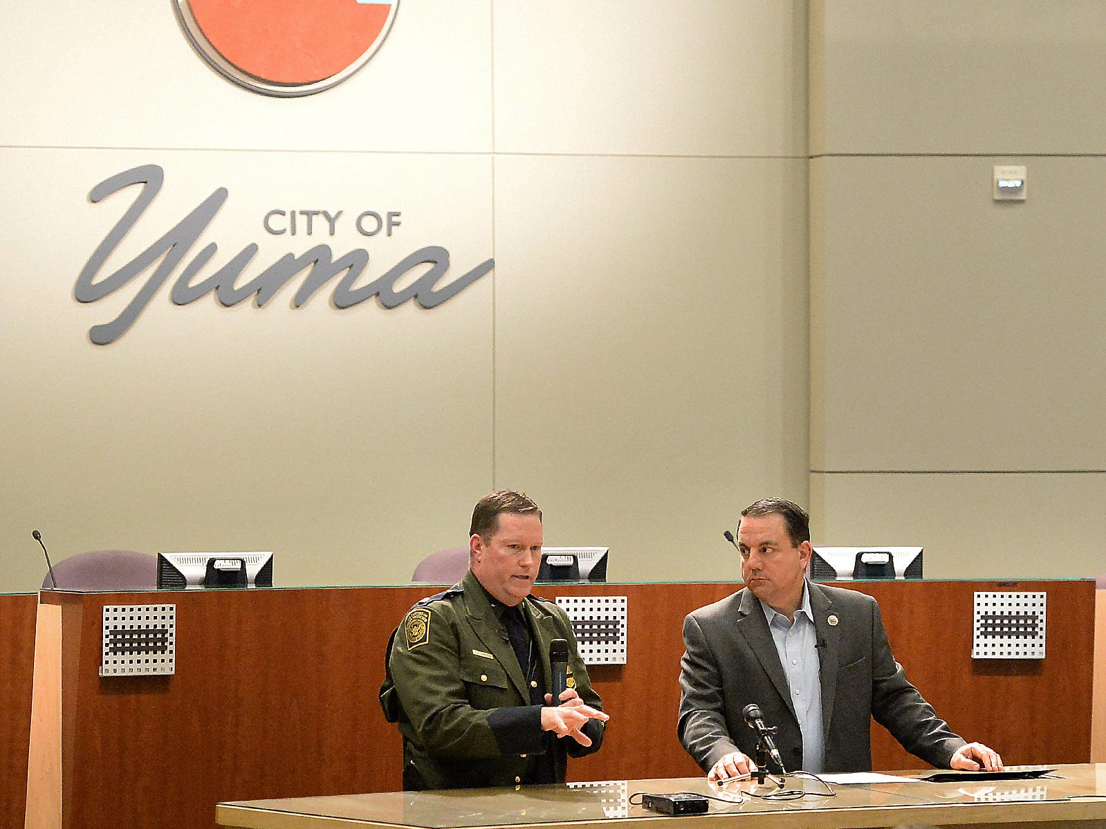 U.S. Border Patrol Deputy Chief Patrol Agent for the Yuma Sector, Carl Landrum (left) answers a question during Yuma Mayor Doug Nicholls' news conference inside Yuma City Council Chambers about the current humanitarian crisis in the border region due to high volumes of illegal migrant crossings  on March 28, 2019, in Yuma.
