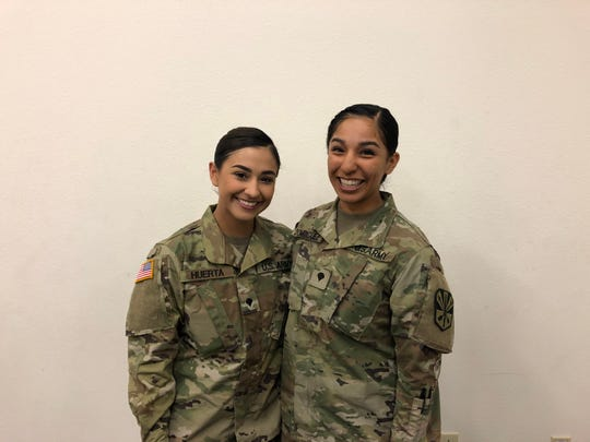 Spc. Kayla Huerta, 21, and Spc. Ana Dominquez, 24.