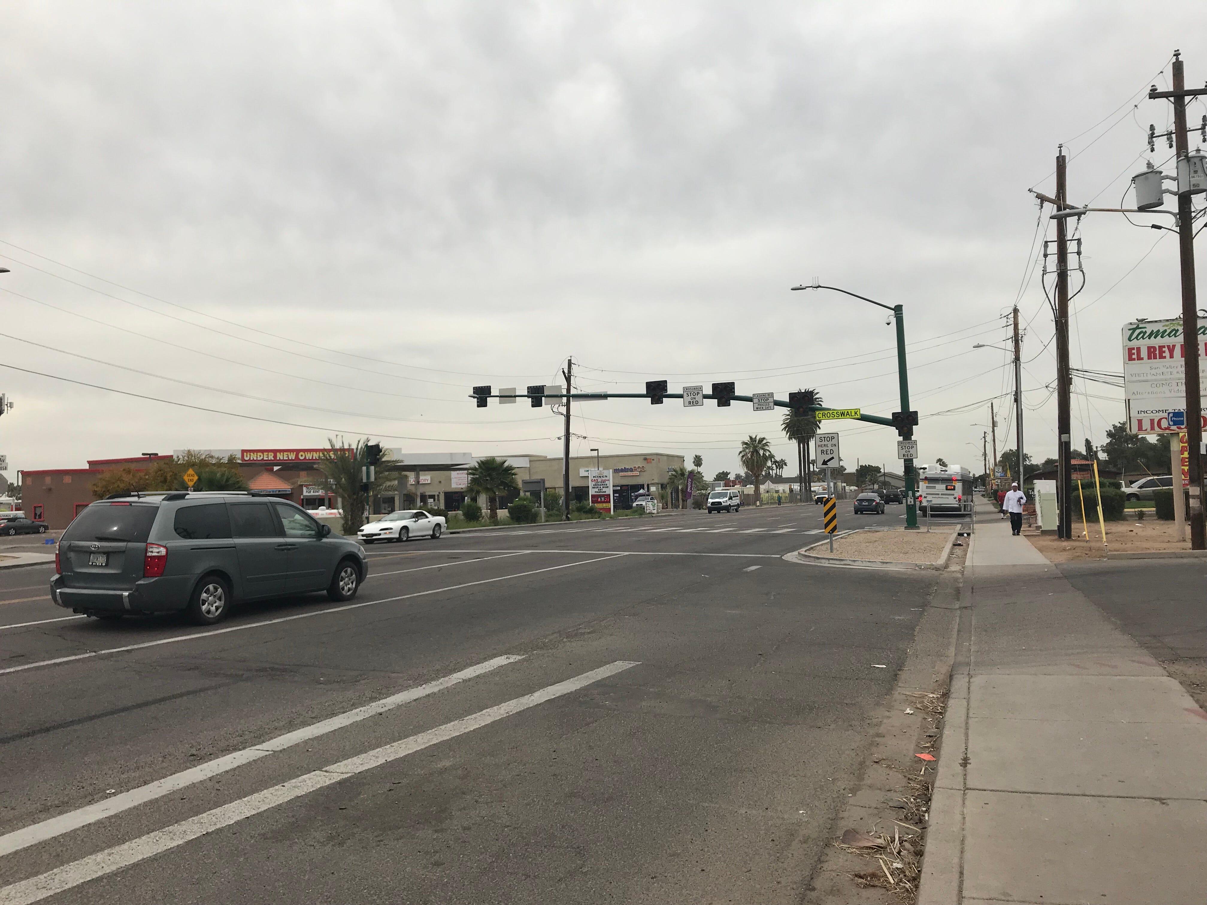On 35th Avenue in Phoenix, a HAWK crossing signal hangs above a crosswalk.