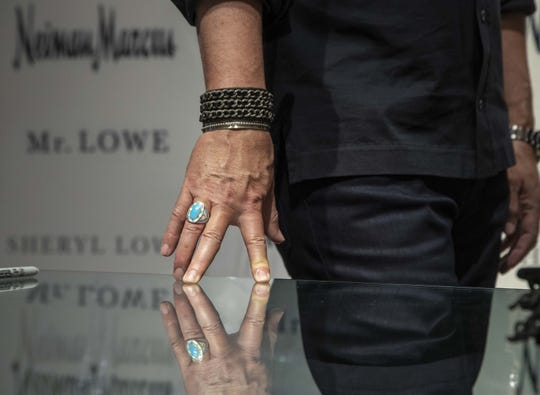 Actor Rob Lowe wears a ring designed by his wife Sheryl Lowe while introducing their new men's jewelry at Scottsdale Fashion Square on March 28, 2019.