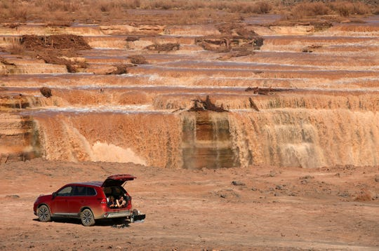 Tourist from Switzerland take a midday break in their car at Grand Falls in the Painted Desert on the Navajo Nation on Mar. 28, 2019 near Leupp, Ariz.