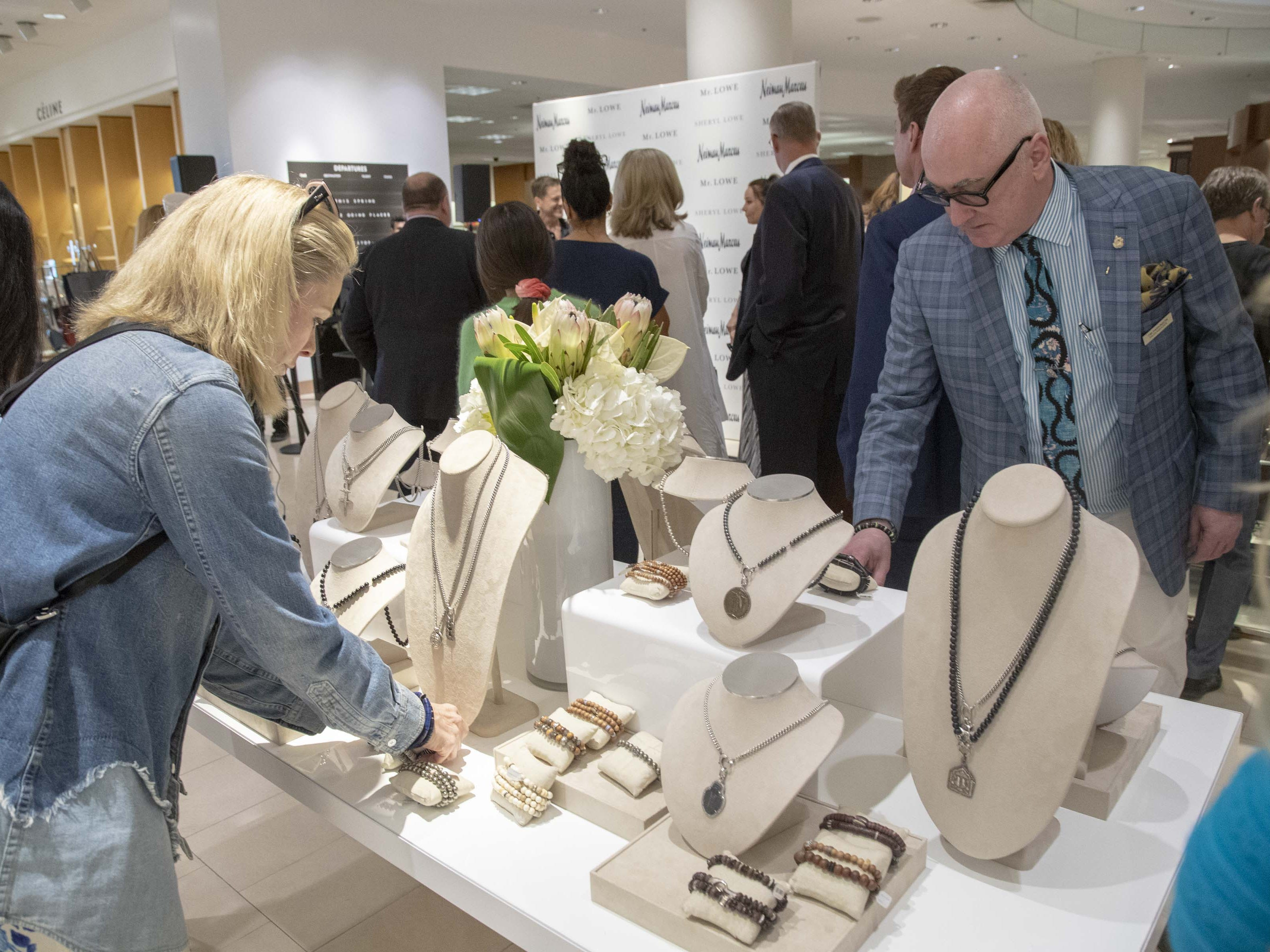 Fans look at actor Rob Lowe and his wife Sheryl Lowe's new jewelry collection at Scottsdale Fashion Square on March 28, 2019.