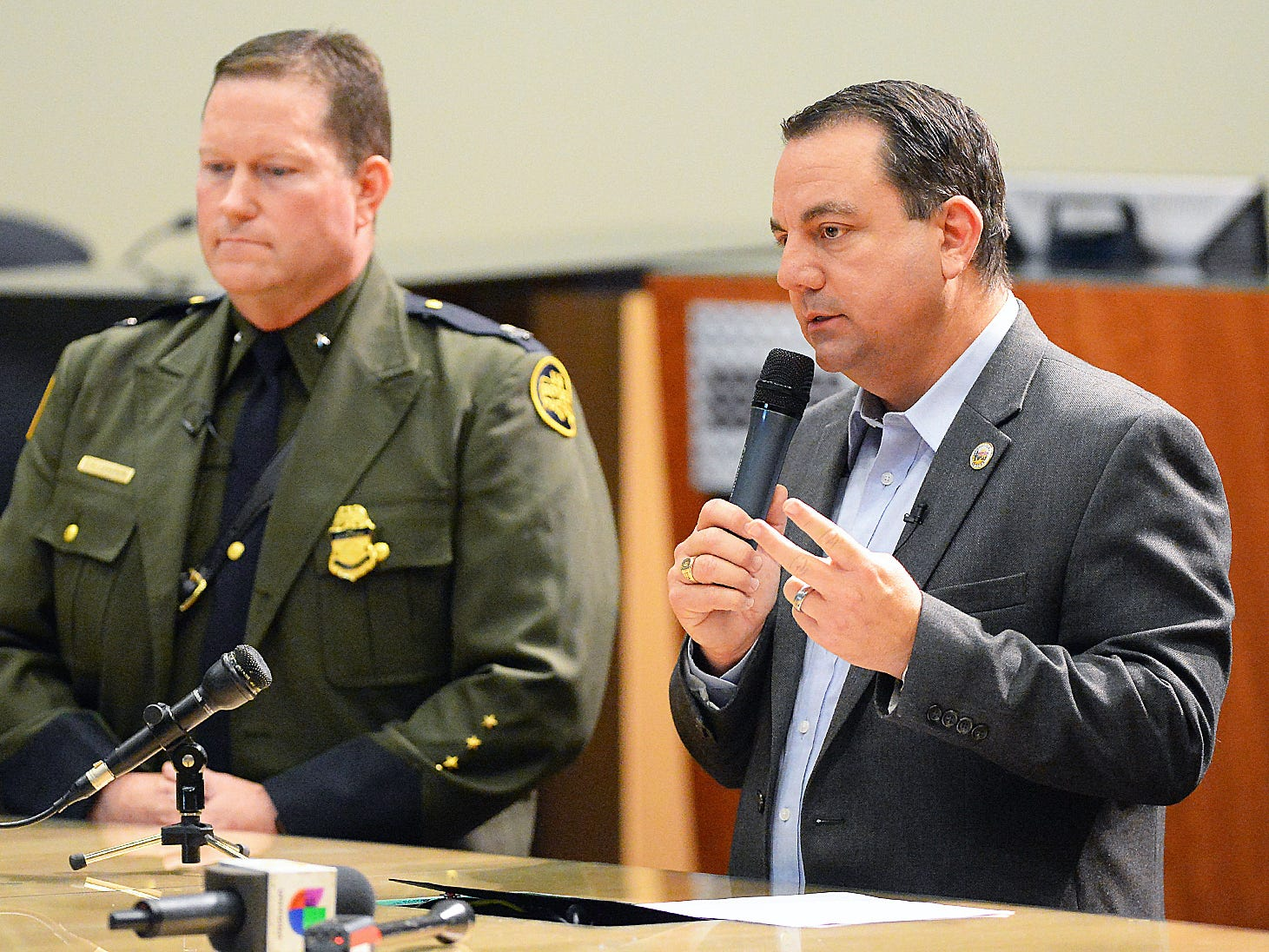 Yuma Mayor Doug Nicholls (right)  answers a question during his news conference inside Yuma City Council Chambers about the current humanitarian crisis in the border region, due to high volumes of illegal migrant crossings, on March 28, 2019, in Yuma. U.S. Border Patrol Deputy Chief Patrol Agent for the Yuma sector, Carl Landrum, is on the left.