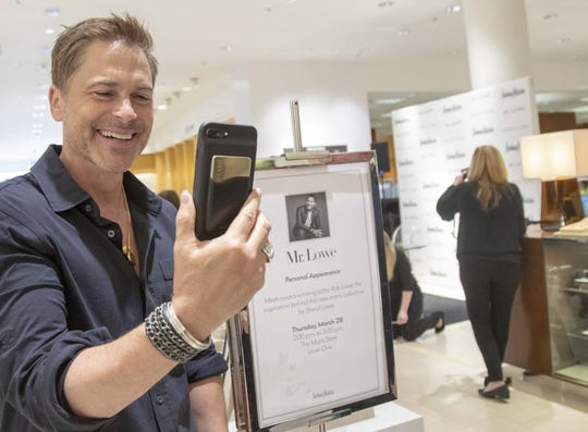 Actor Rob Lowe wears a ring designed by his wife Sheryl Lowe while introducing their new men's jewelry collection at Scottsdale Fashion Square on March 28, 2019.