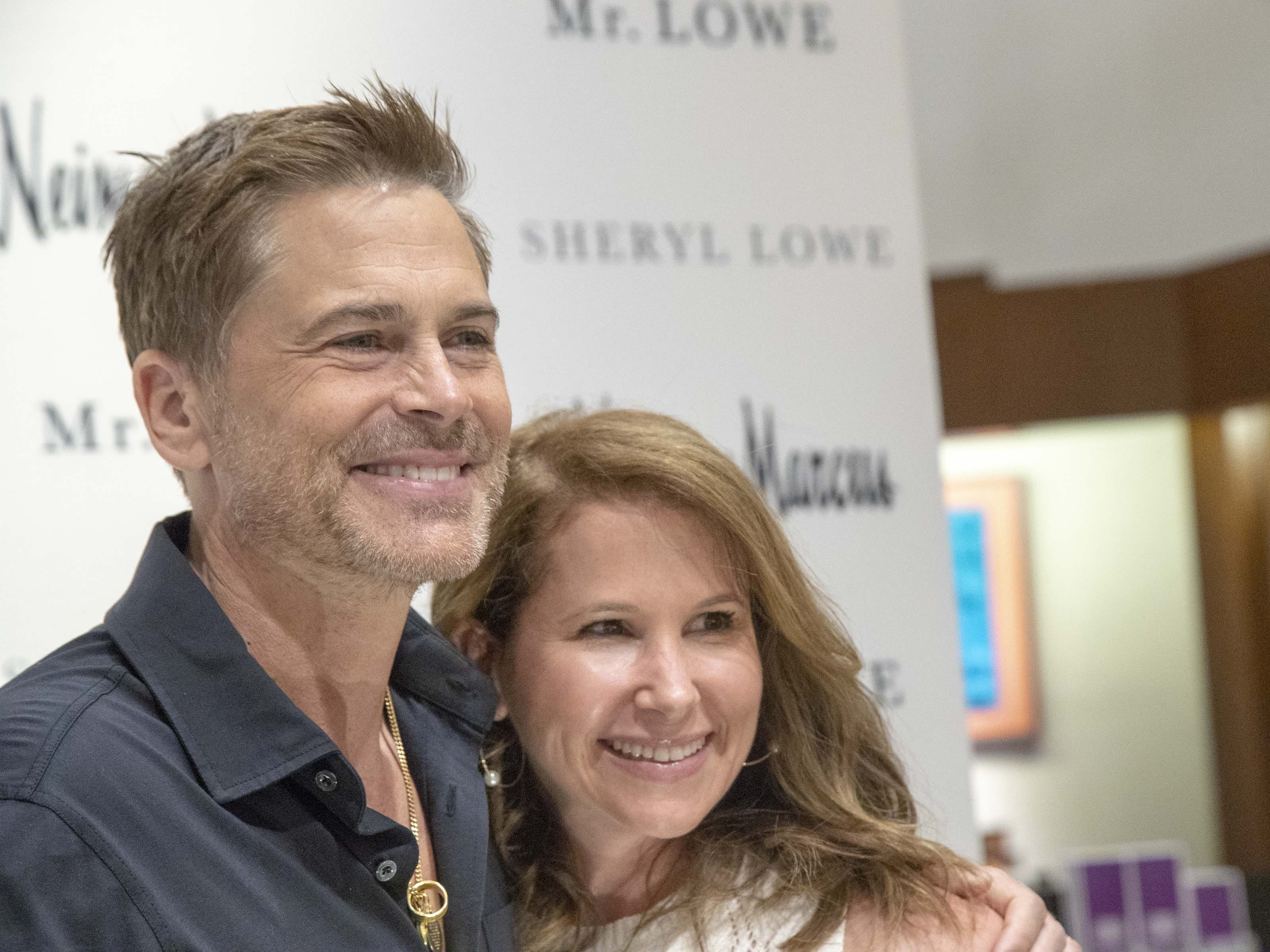 Fans take photos with actor Rob Lowe during an event introducing his new men's jewelry collection at Scottsdale Fashion Square on March 28, 2019.