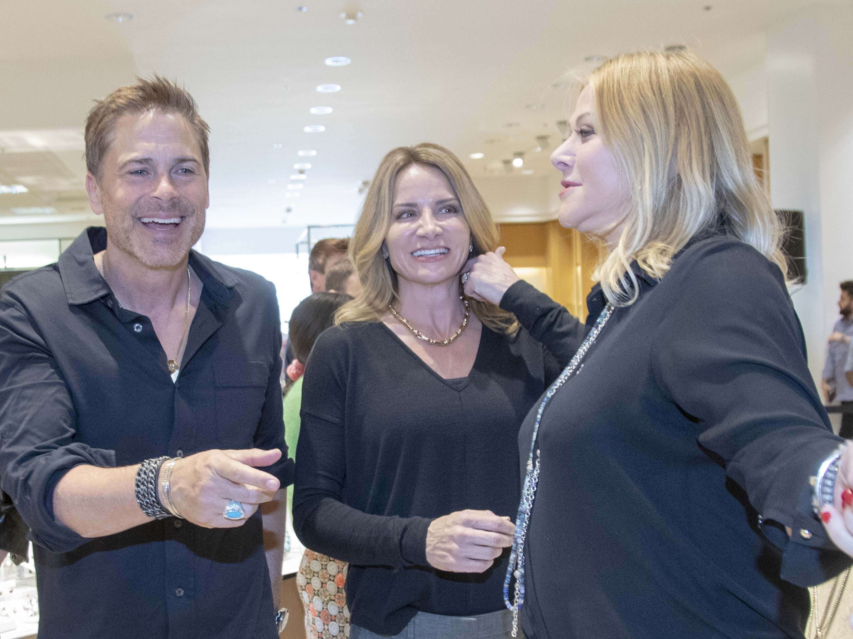 Actor Rob Lowe, on left and his jewelry-designer wife Sheryl Lowe, on far right, introduce their new men's jewelry collection exclusively to Neiman Marcus at Scottsdale Fashion Square on March 28, 2019.