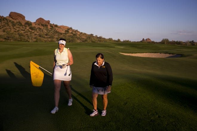 Olivia Mehaffey and head coach Missy Farr-Kaye walk together after practice on Tuesday, Mar. 19, 2019, at The Thunderbirds Golf Complex in Phoenix.