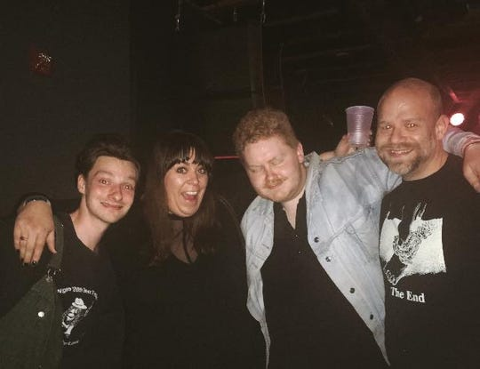 Annamarie Sanchez and Matt Francis with members of Her's after their final concert at the Rebel Lounge in Phoenix.