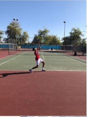 Brophy Prep serves against Chandler in tennis singles match on March 28, 2019.