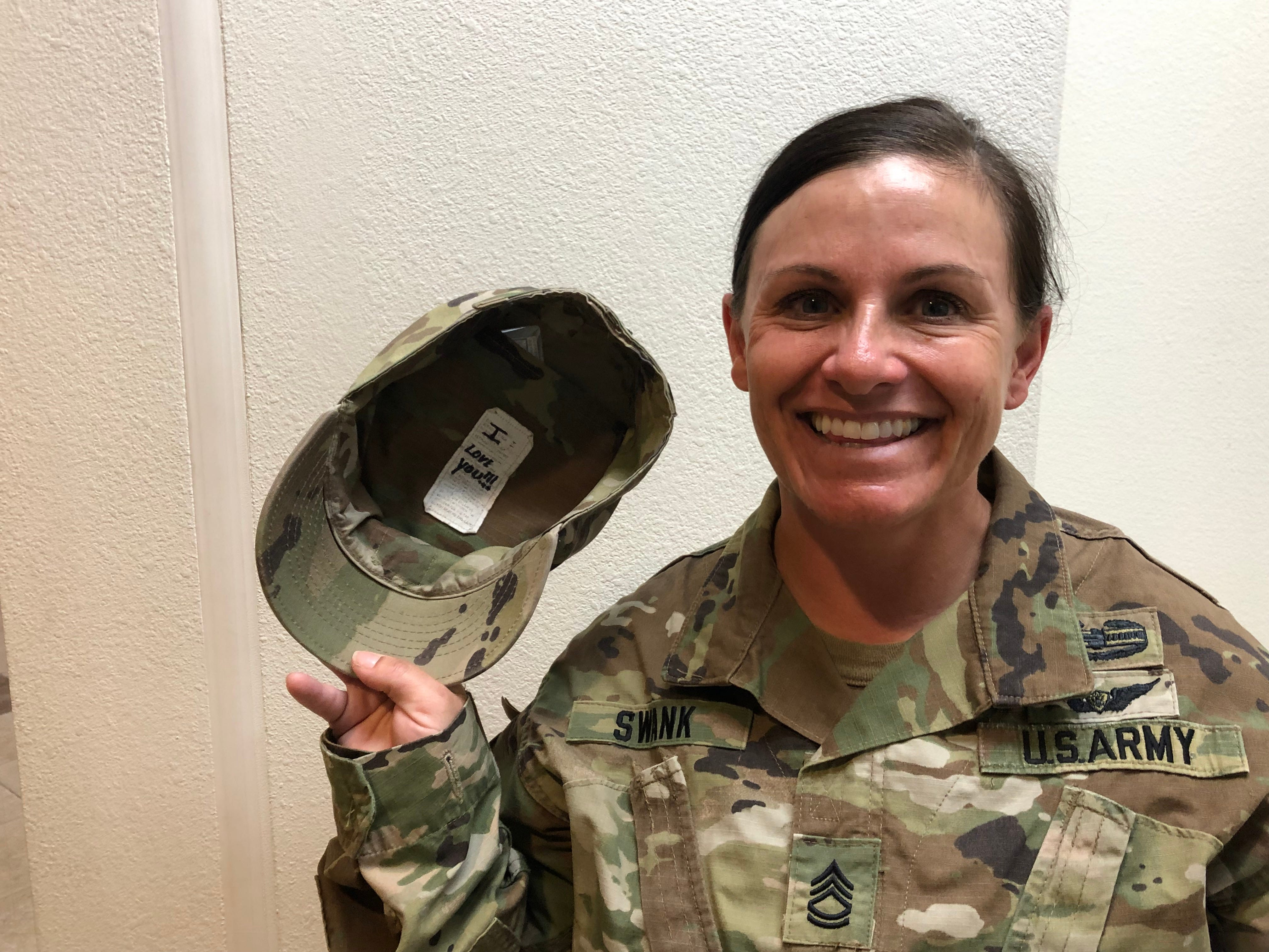 Sgt. 1st Class Teresa Swank's husband leaves a note in her hat.