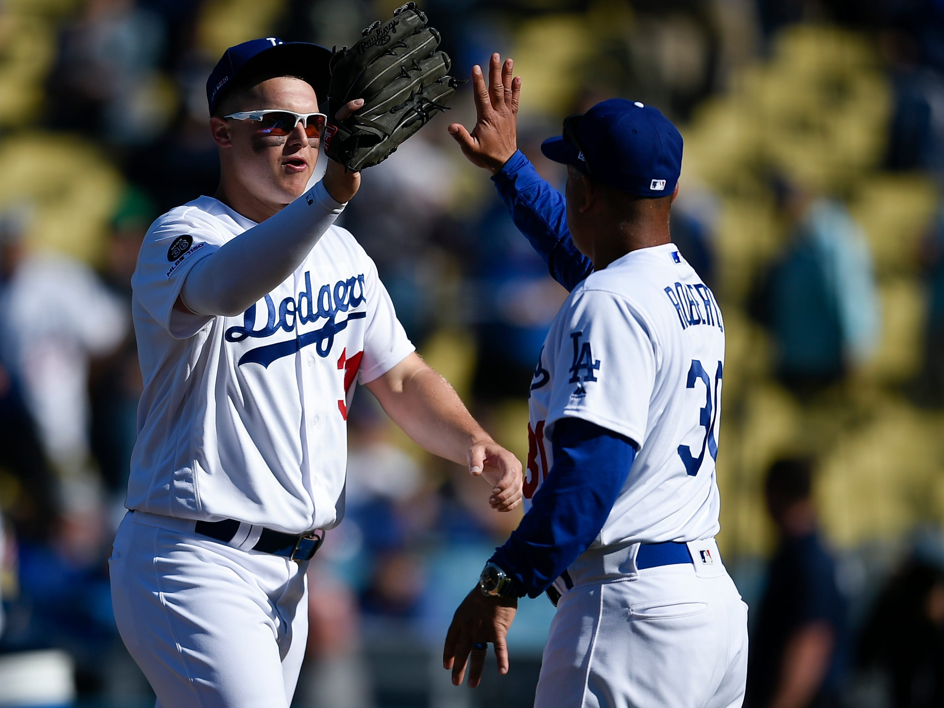 Mar 28, 2019; Los Angeles, CA, USA; Los Angeles Dodgers left fielder Joc Pederson (31) celebrates with manager Dave Roberts (right) after the game against the Arizona Diamondbacks at Dodger Stadium.