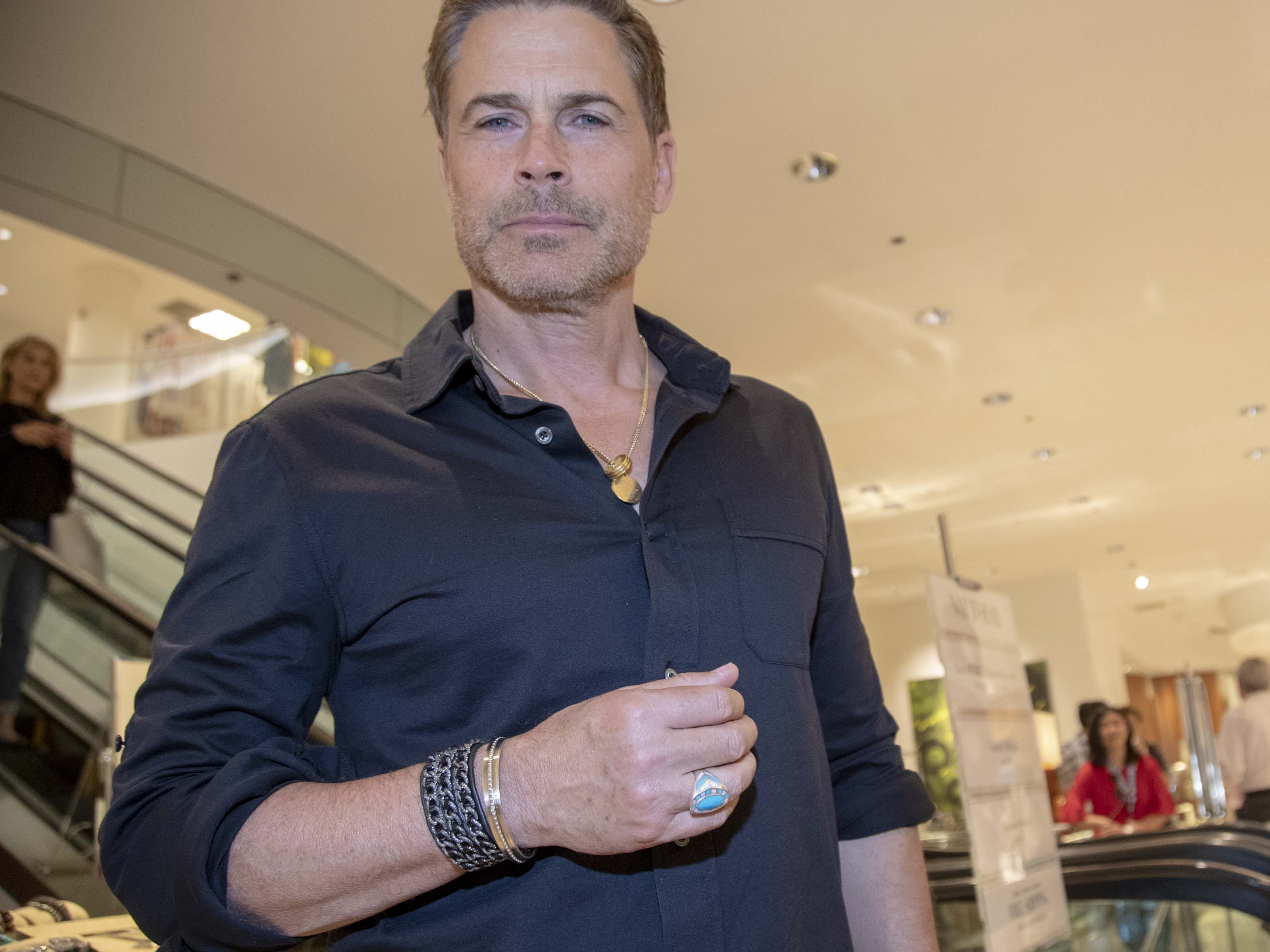 Actor Rob Lowe wears a ring designed by his wife Sheryl Lowe while introducing the couple's new men's jewelry collection at Scottsdale Fashion Square on March 28, 2019.