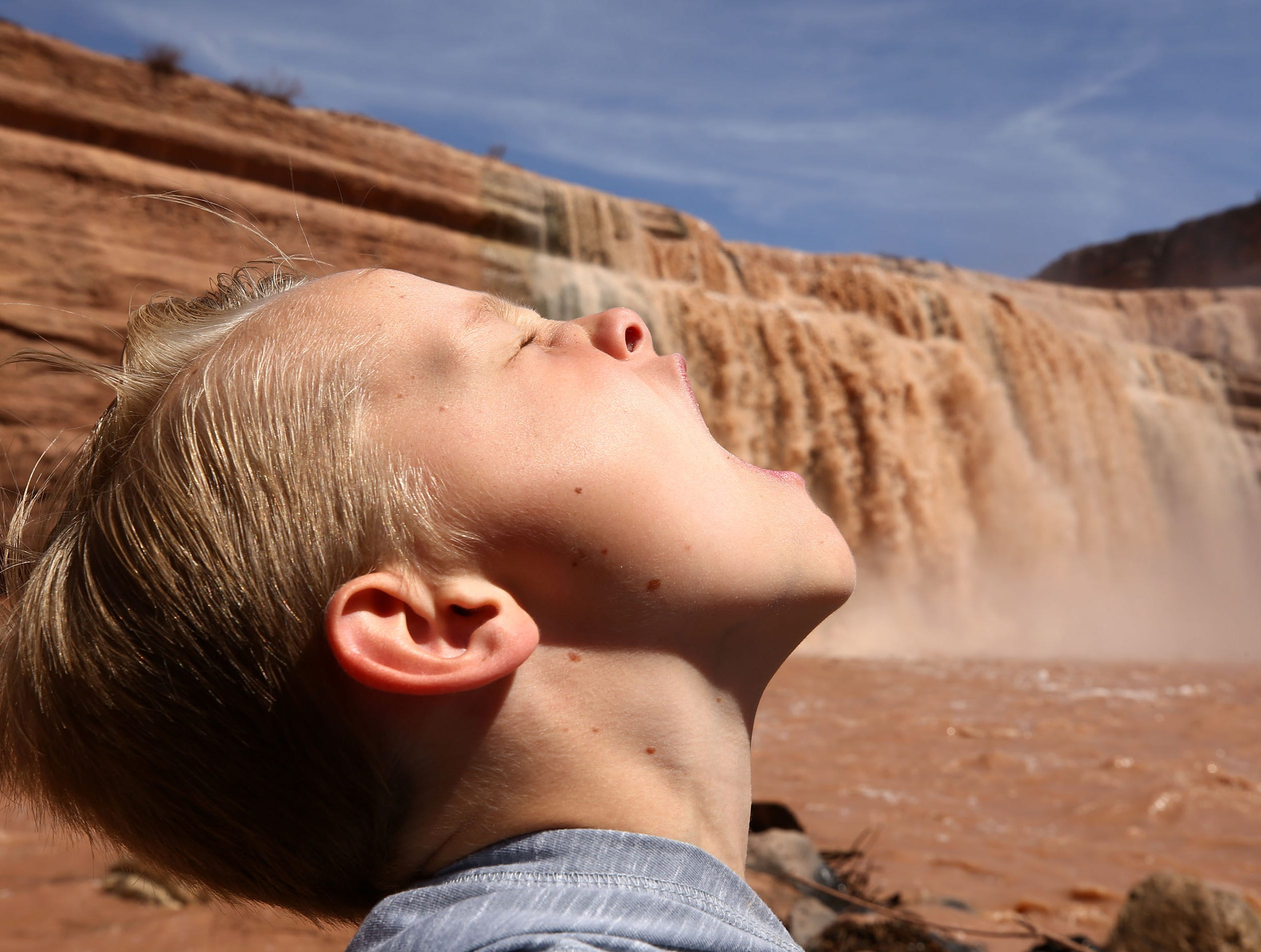 Luke St. John, age 7, has some fun at Grand Falls in the Painted Desert on the Navajo Nation on March 28, 2019, near Leupp, Arizona. Melted snow and rain travels down the Little Colorado River to the 185-foot fall a.k.a. Chocolate Falls. Grand Falls is 18 feet taller than Niagara Falls.