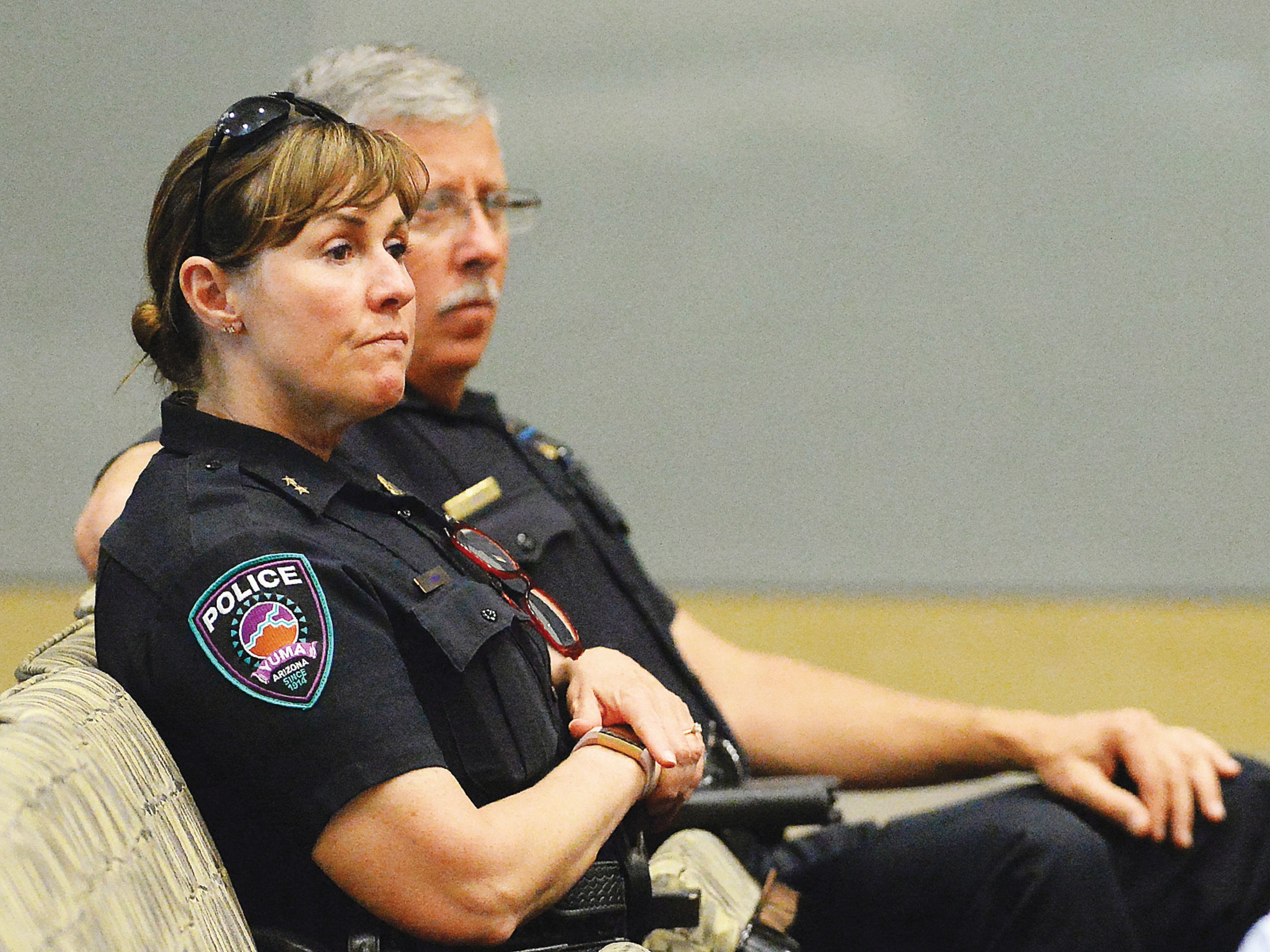 Incoming Yuma Police Department Chief Susan Smith (left) and Capt. Stephen Suho Jr. listen to Yuma Mayor Doug Nicholls' news conference about the current humanitarian crisis in the border region due to high volumes of illegal migrant crossings on March 28, 2019, in Yuma. Nicholls said the city is working with various non-governmental organizations to make sure the families have temporary housing, food, medical care and help with travel to their intended destinations.