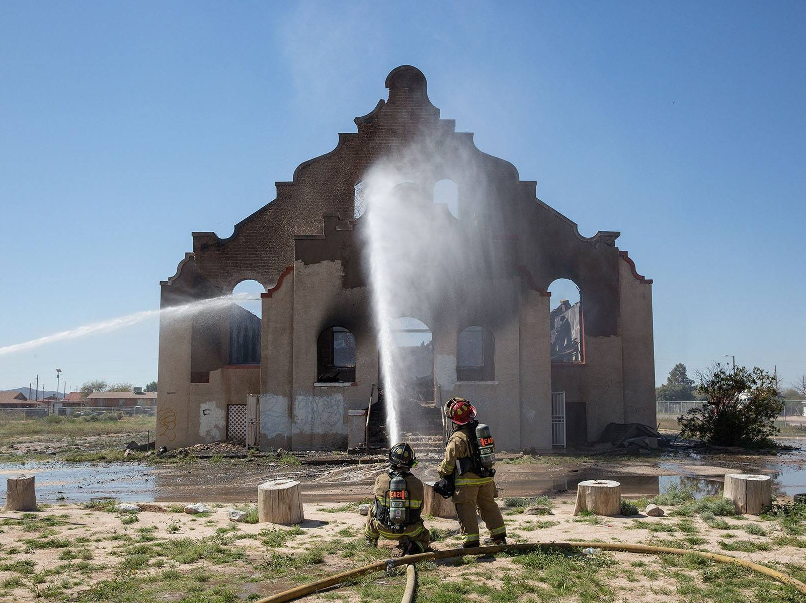 Gila River firefighters work to put out the last of the flames.