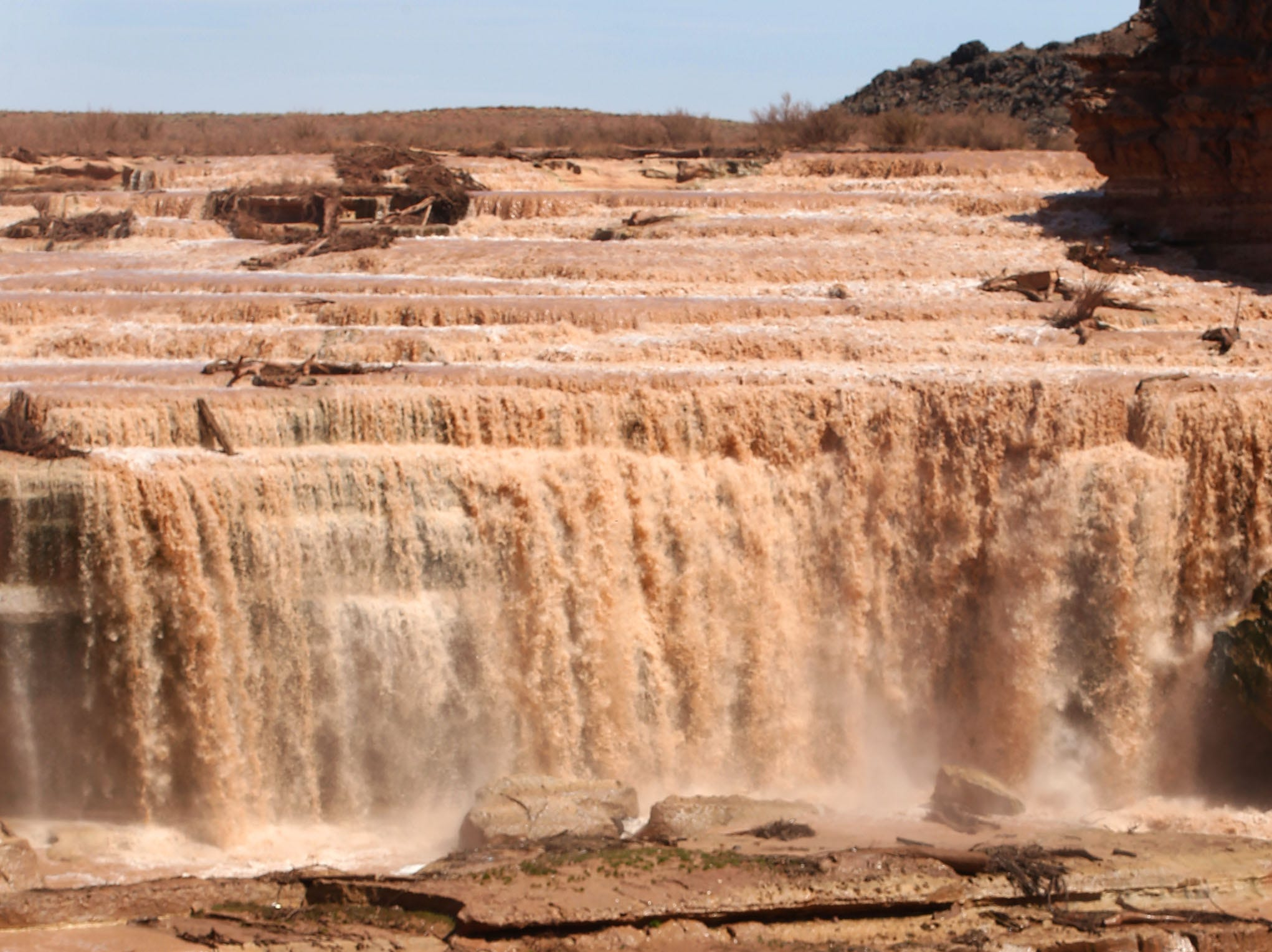 Sunny St. John of Phoenix photographs Grand Falls in the Painted Desert on the Navajo Nation on March 28, 2019, near Leupp, Arizona. Melted snow and rain travels down the Little Colorado River to the 185-foot fall a.k.a. Chocolate Falls. Grand Falls is 18 feet taller than Niagara Falls.