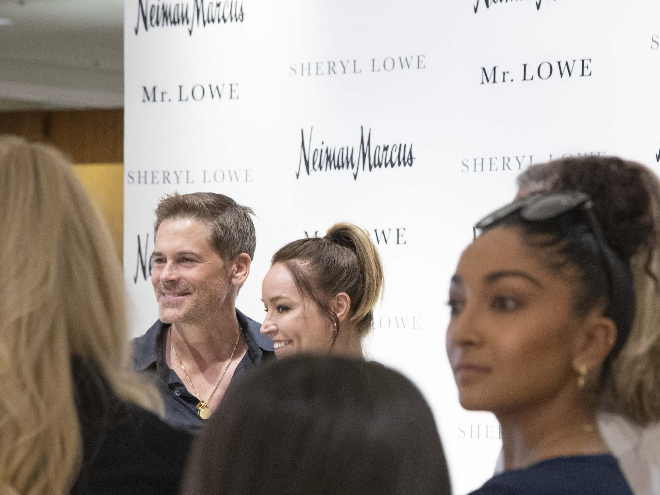 Actor Rob Lowe gets his photo taken with fans during an event introducing his new men's jewelry collection at Scottsdale Fashion Square on March 28, 2019.