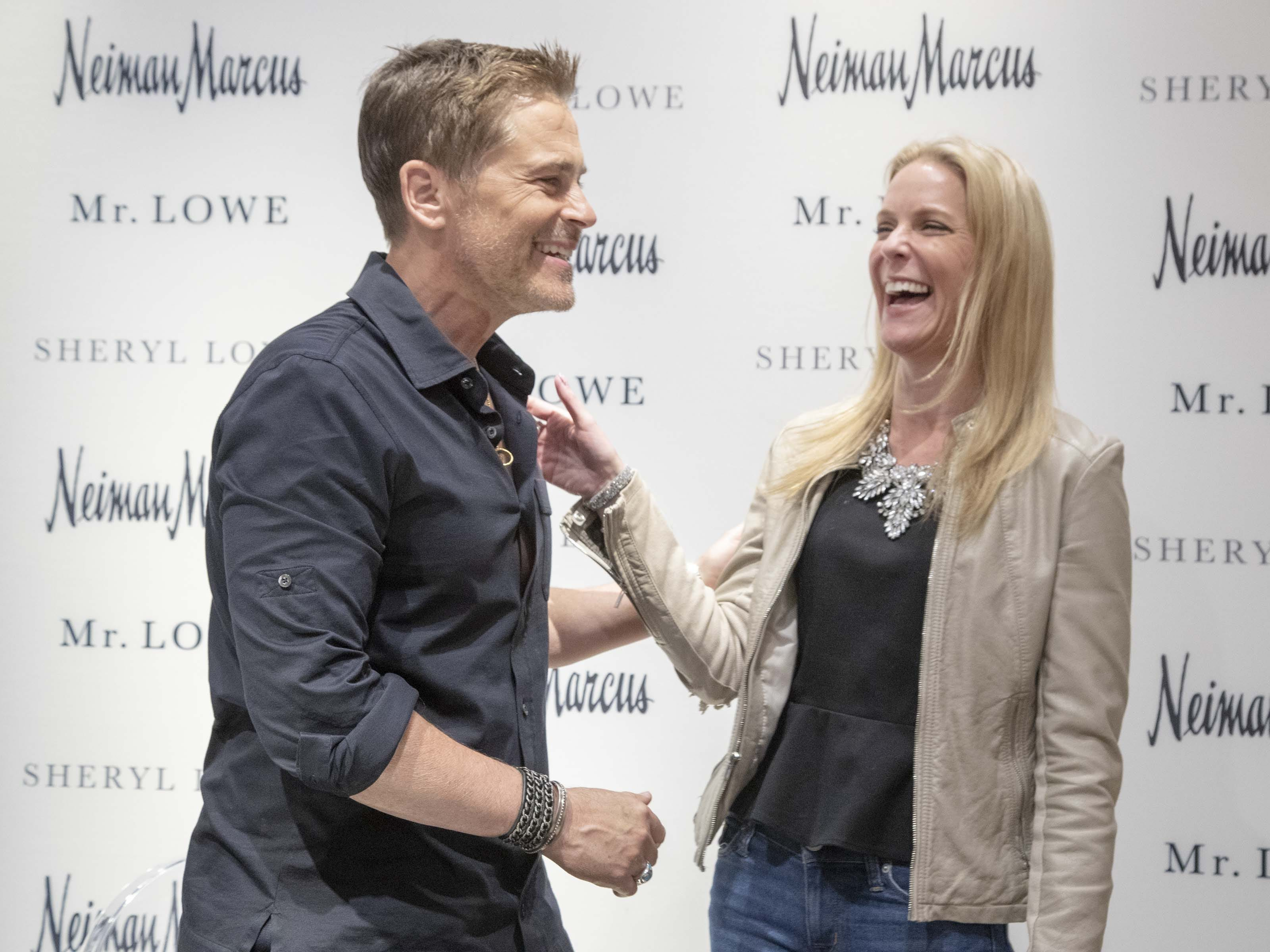 Actor Rob Lowe shares a laugh with his fan Alison Johnson during an event introducing his new men's jewelry collection at Scottsdale Fashion Square on March 28, 2019.