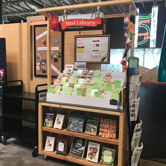 The Seed Library featuring an array of relevant reading material at Phoenix's Agave Library in March 2019.