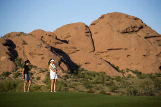 Madison Kerley and Olivia Mehaffey, right, practice at The Thunderbirds Golf Complex on March 19.