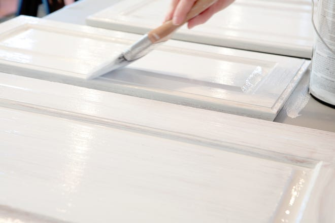 You'll need patience, a steady hand and an eye for details to refinish or repaint cabinets.