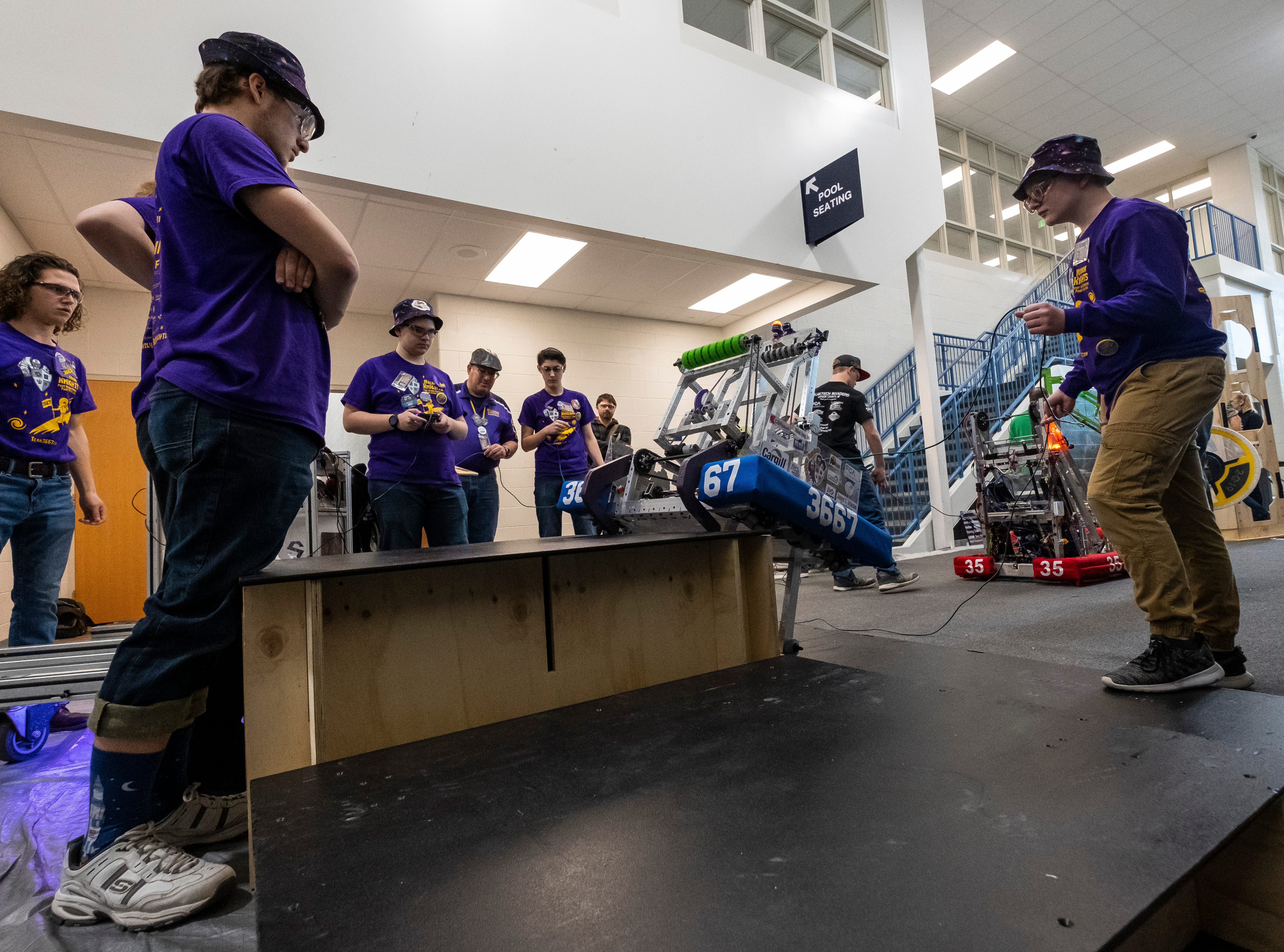 The Port Huron  Mecanum Knights watch as their robot climbs a step Friday, March 29, 2019 before the FIRST Robotics district event at Marysville High School.
