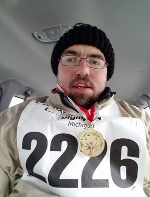 Brian Larson wears a gold medal he won for the sport of snowshoeing in the Special Olympics in 2017.