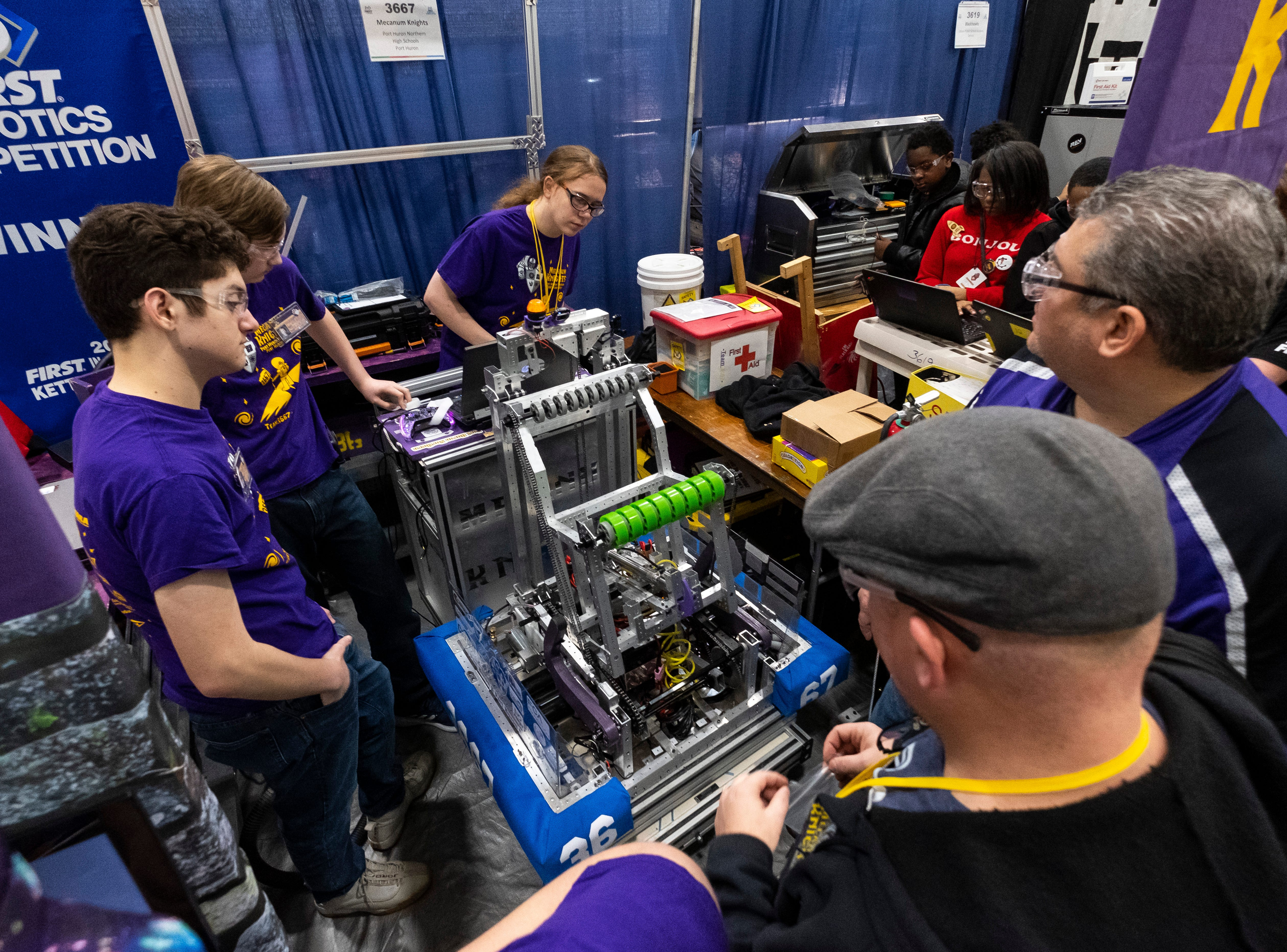 The Port Huron Mecanum Knights make last-minute adjustments to their robot before the FIRST Robotics district event Friday, March 29, 2019 at Marysville High School.