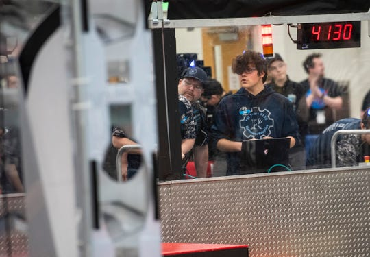 Luke Evans, right, Richmond Blue Devils driver and electrical captain, commands his team's robot during the FIRST Robotics district event Friday, March 29, 2019 at Marysville High School. This year, the Blue Devils designed their robot to be balanced, so that they could coordinate play to complement their alliance partners.