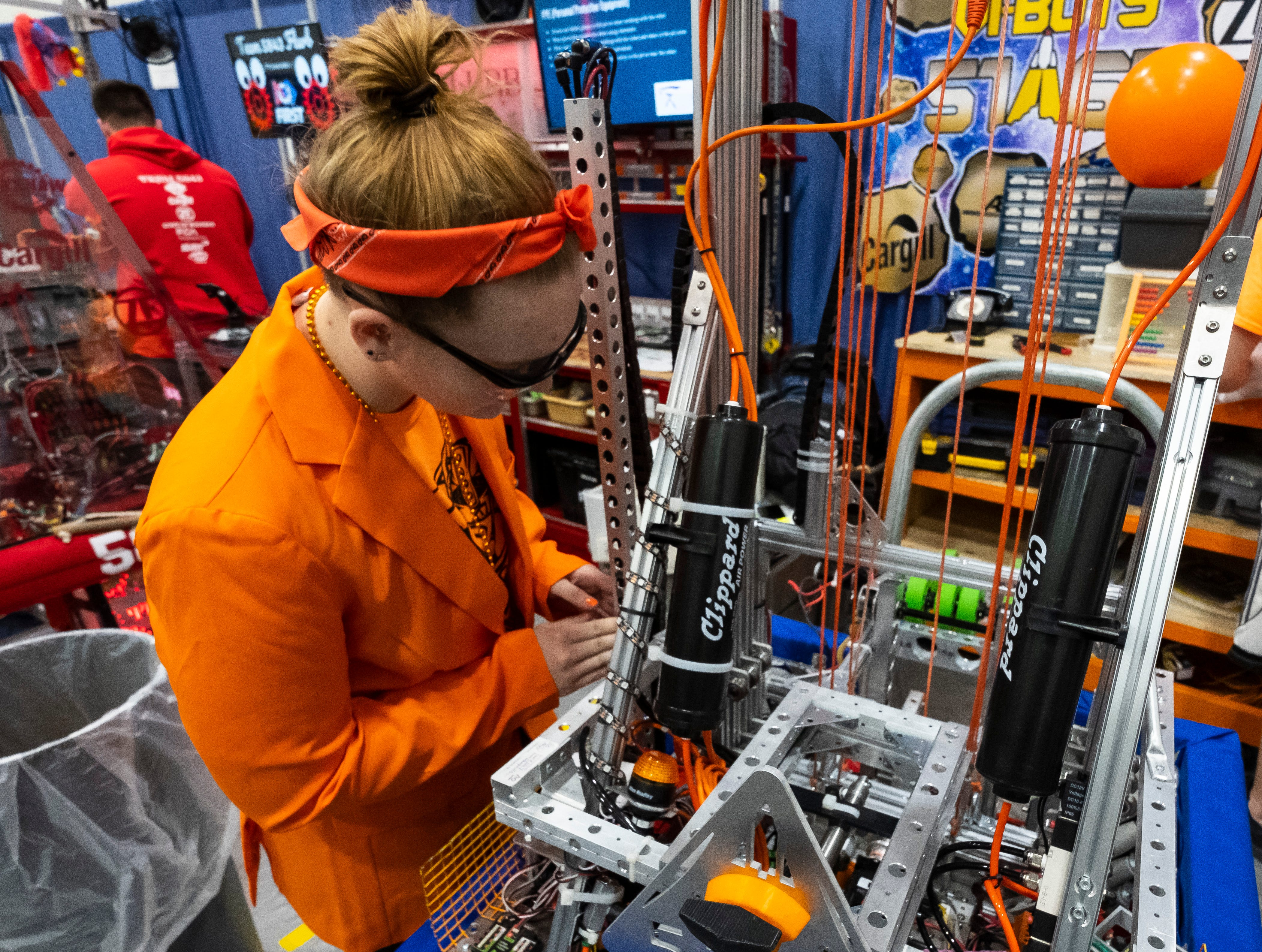 Marysville High School junior Avery Turner, 16, works on making final adjustments to her team's robot Friday, March 29, 2019 before competing in the FIRST Robotics district event at Marysville High School.