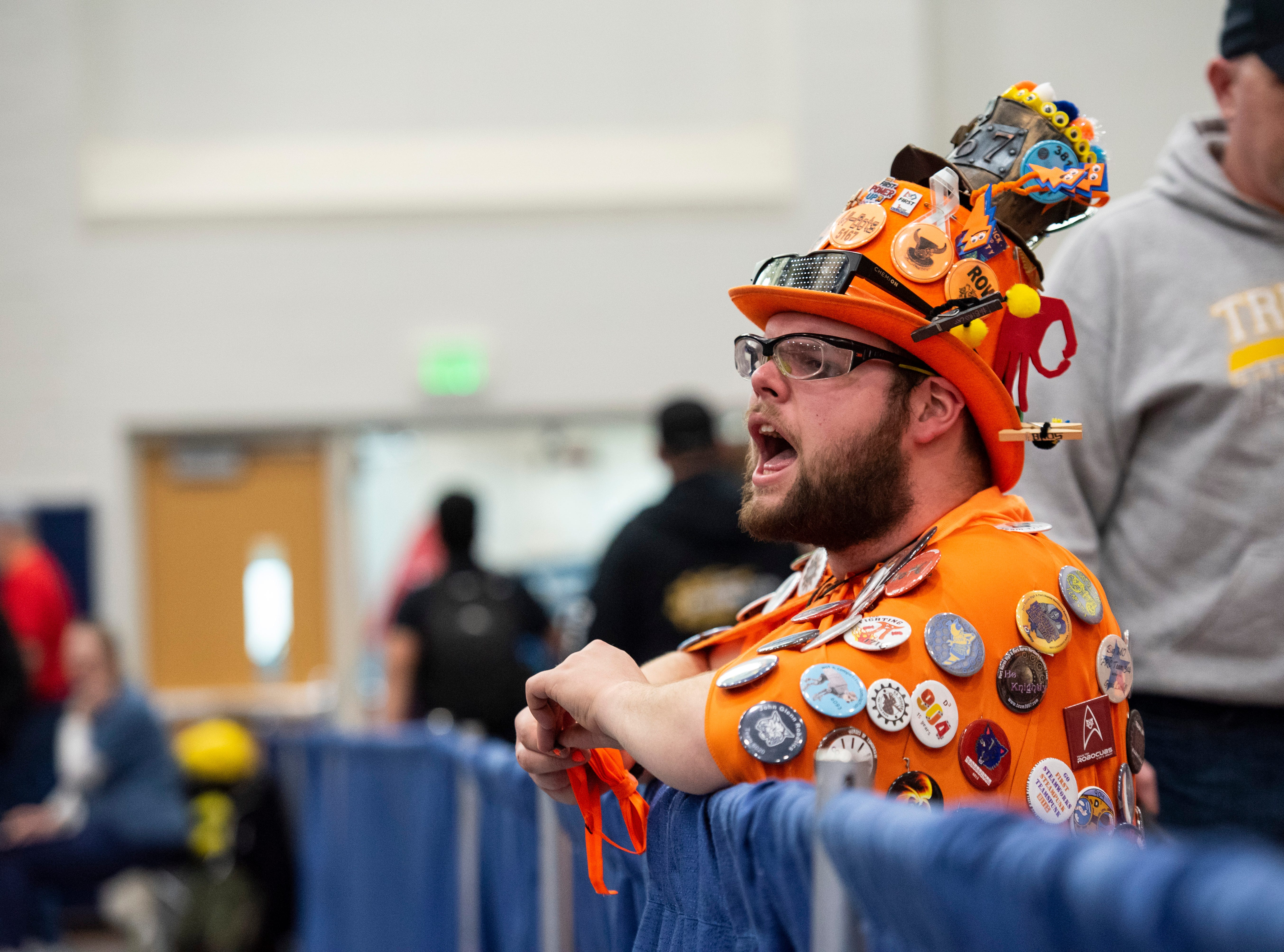Marysville senior Dion Stephenson cheers from the crowd during the FIRST Robotics district event Friday, March 29, 2019 at Marysville High School.