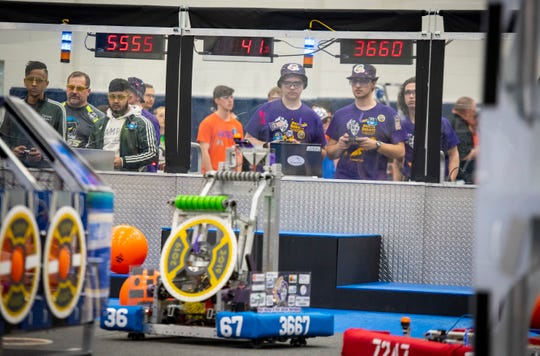 Port Huron sophomore Matthew Herber and senior Ryan Churchill operate the Mecanum Knight's robot 3667 during the first round of the FIRST Robotics district event Friday, March 29, 2019 at Marysville High School. The team won at theKettering II District Event and looked to replicate their success in Marysville.