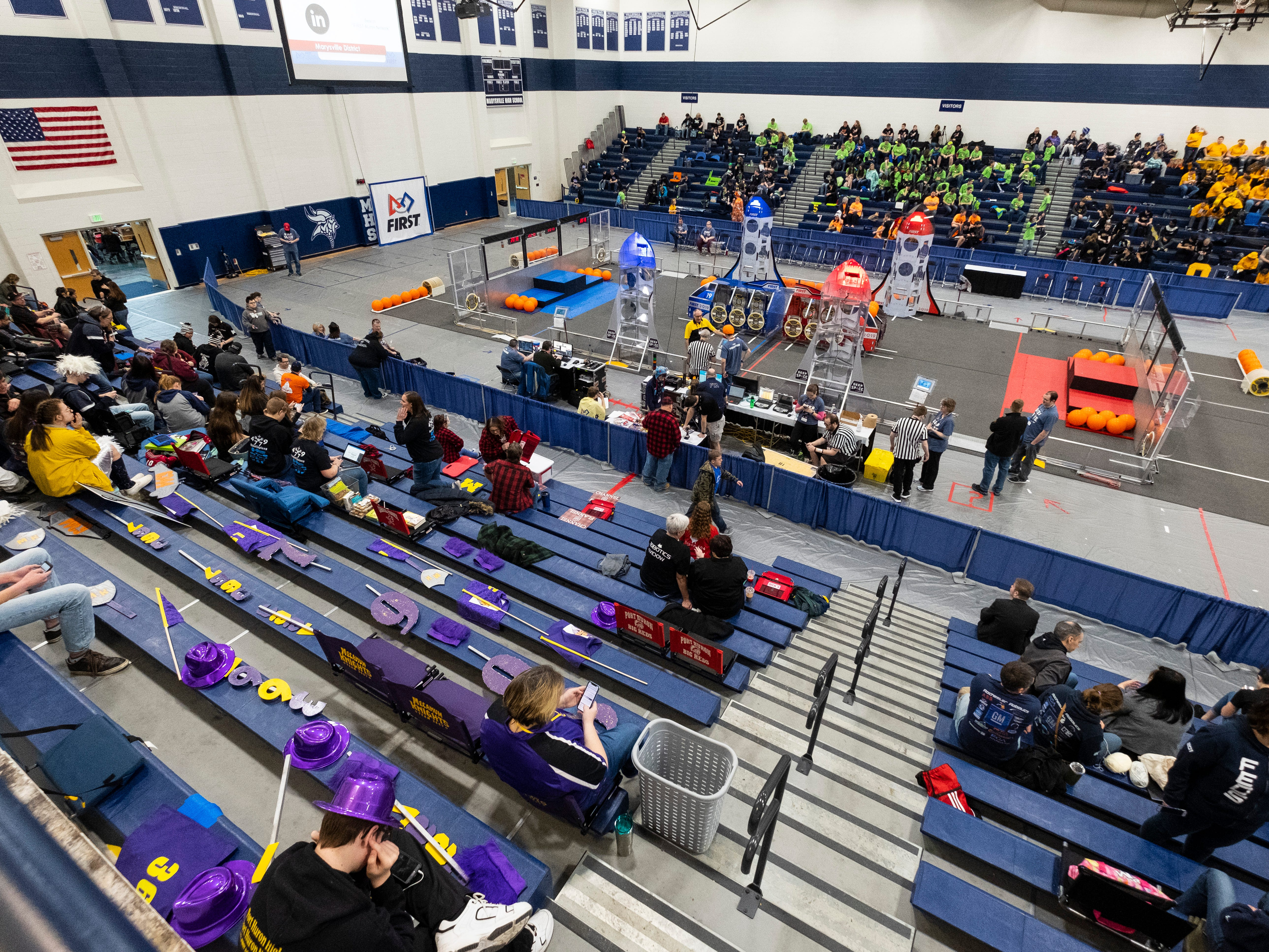 Spectators begin to fill the gymnasium at Marysville High School before the FIRST Robotics district event Friday, March 29, 2019.