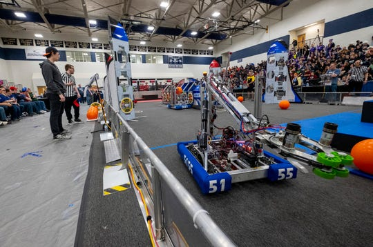 Team 5155's robot competes during the FIRST Robotics district event Friday, March 29, 2019 at Marysville High School.