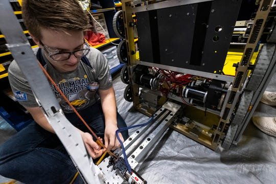 Algonac High School junior Eddy Boughner, 16, works to make the winch on his team's robot return to its position automatically before competing in the FIRST Robotics district event Friday, March 29, 2019 at Marysville High School.
