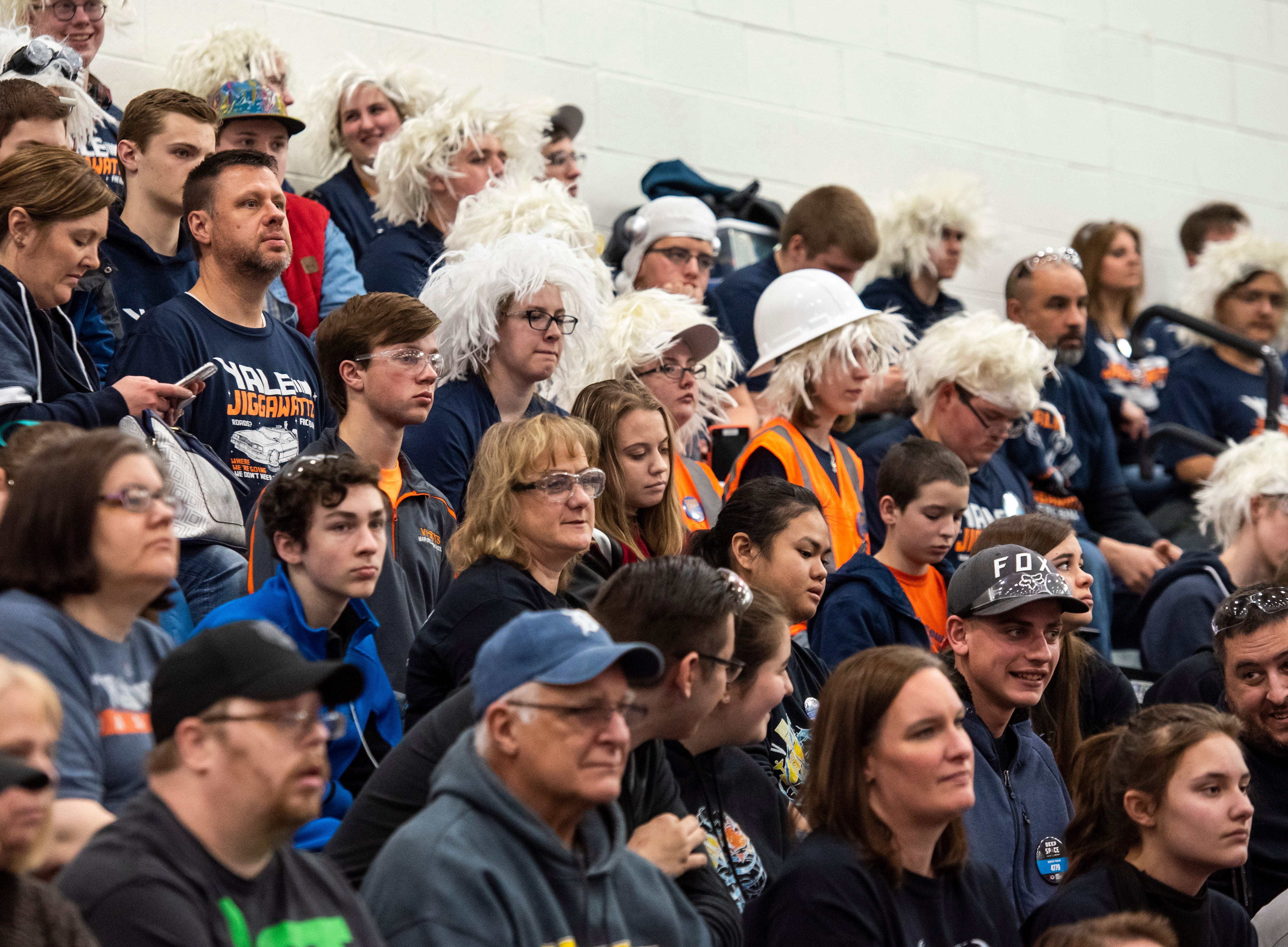 Spectators cheer from the stands during the FIRST Robotics district event Friday, March 29, 2019 at Marysville High School. About 40 robotics teams came to compete in the fourth annual event.
