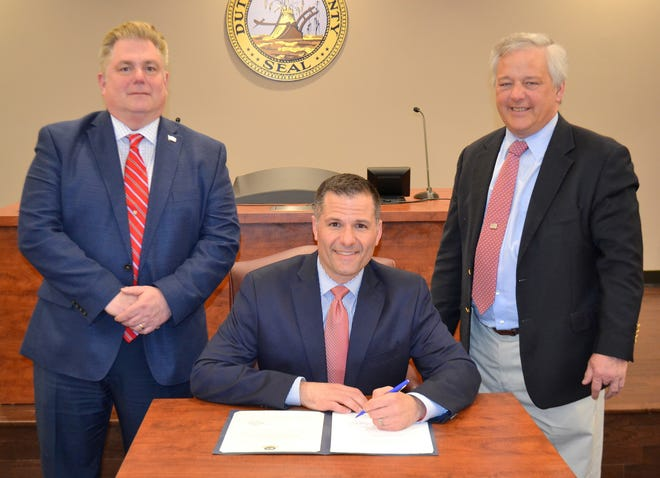 Dutchess County Executive Marc Molinaro signs into law term limits for some elected officials on Thursday.
