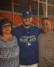 Toronto Blue Jays draft pick Mike Pascoe poses between his parents, Liz and Ken Pascoe.