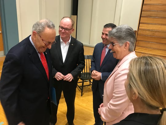 U.S. Sen. Charles Schumer (left) laughs with Poughkeepsie Mayor Rob Rolison (second from left), Dutchess County Executive (third from left) and President and CEO of Dutchess Tourism Mary Kay Vrba (fourth from left) before speaking at Dutchess Community College on Friday. He announced he will push for more federal funding for the Special Olympics.
