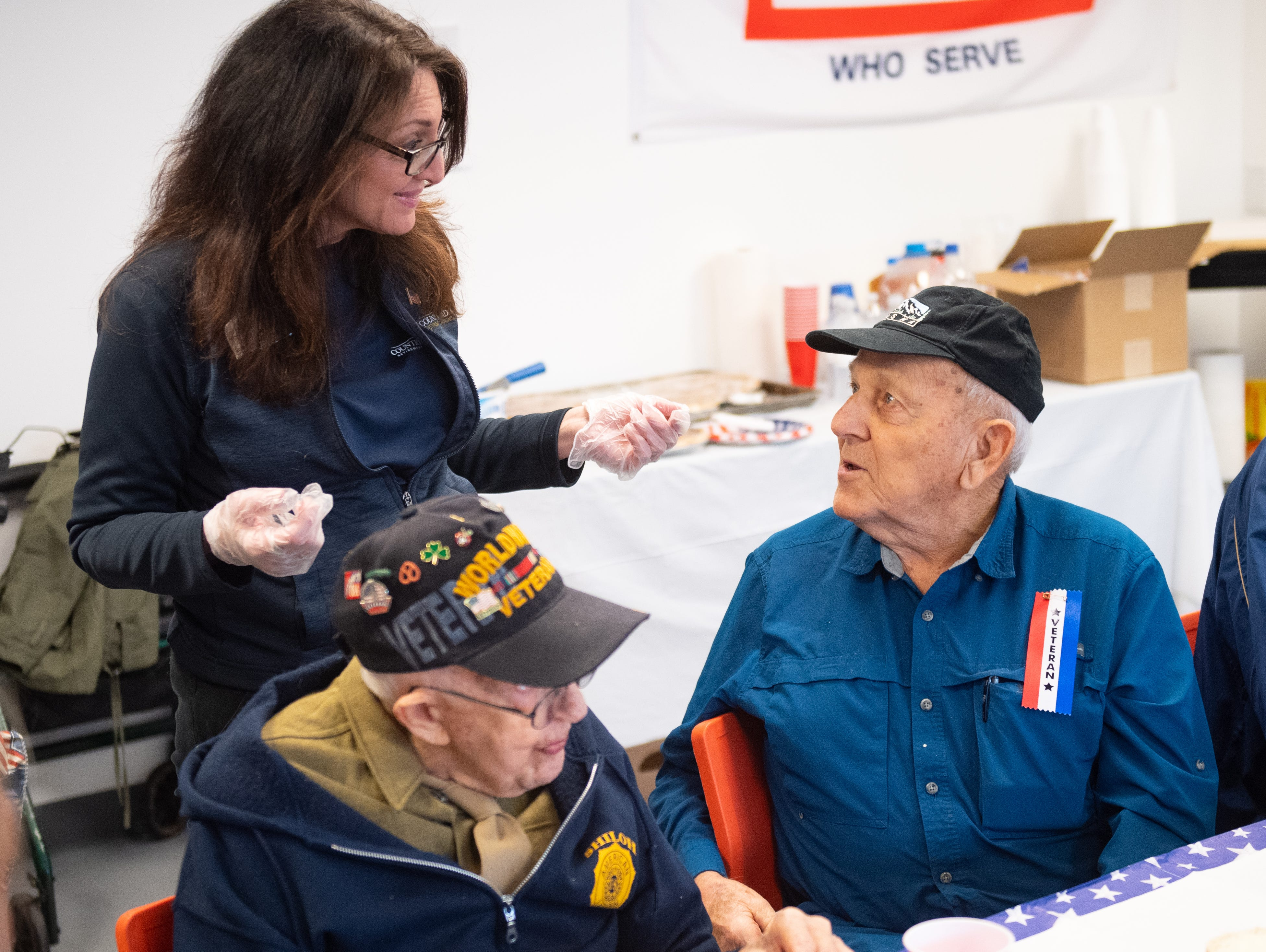 Irvin Baughman a World War II Air Force veteran shares stories with Bonnie Geisinger, Director of Community Life at York County Meadows Retirement Communities, March 29, 2019.