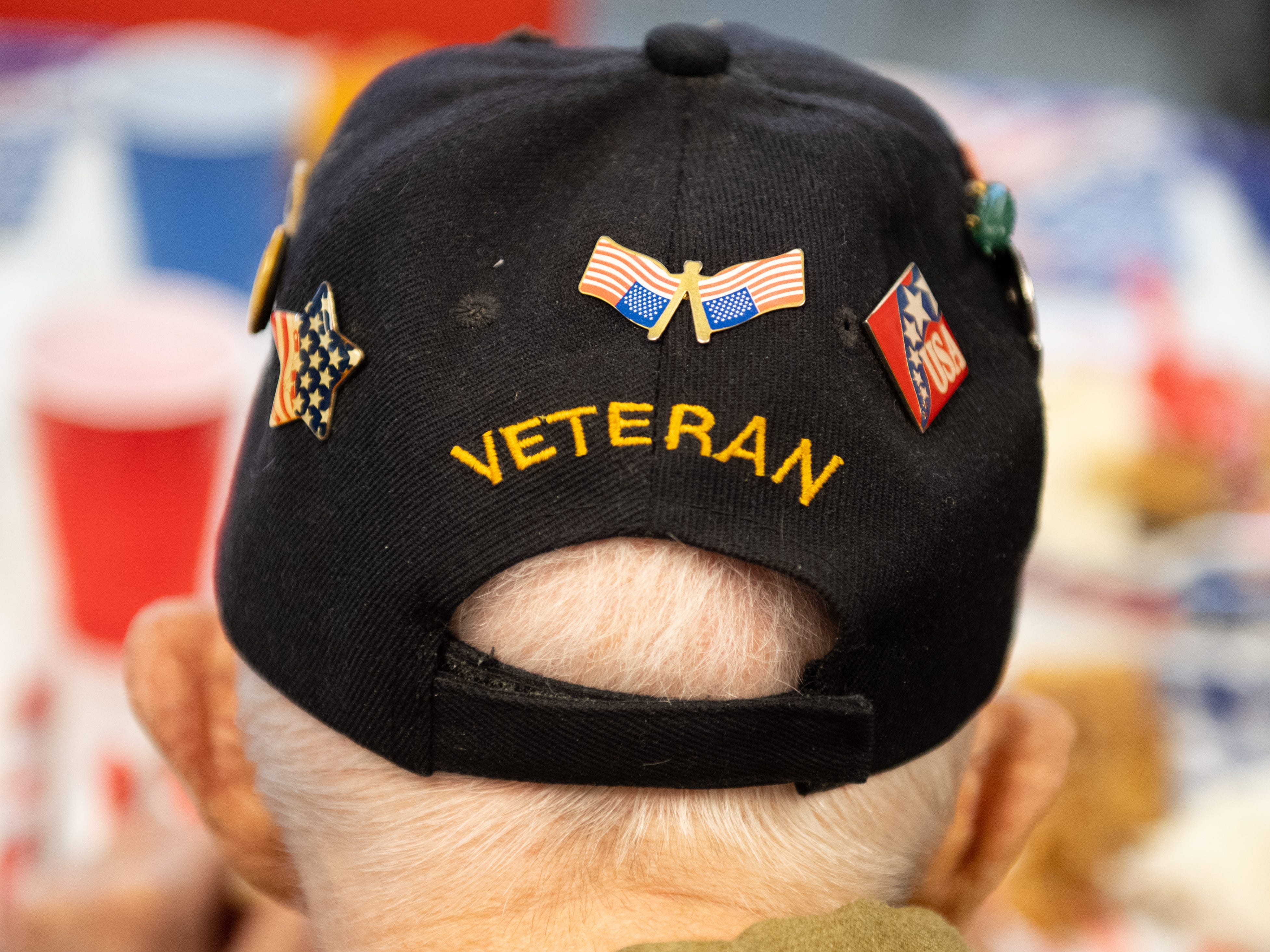 Some veterans in attendance wore hats and shirts showing their pride.