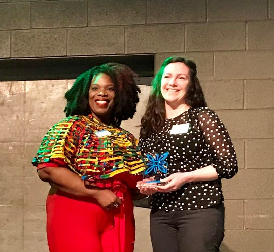 Molly's Courtyard Cafe won for Outstanding Merchant at the Downtown First Awards Thursday, March 28, 2019 at Logos Academy.  Accepting the award is Molly Fisher, right, standing with Mylea Thompson, events manager for Downtown Inc.