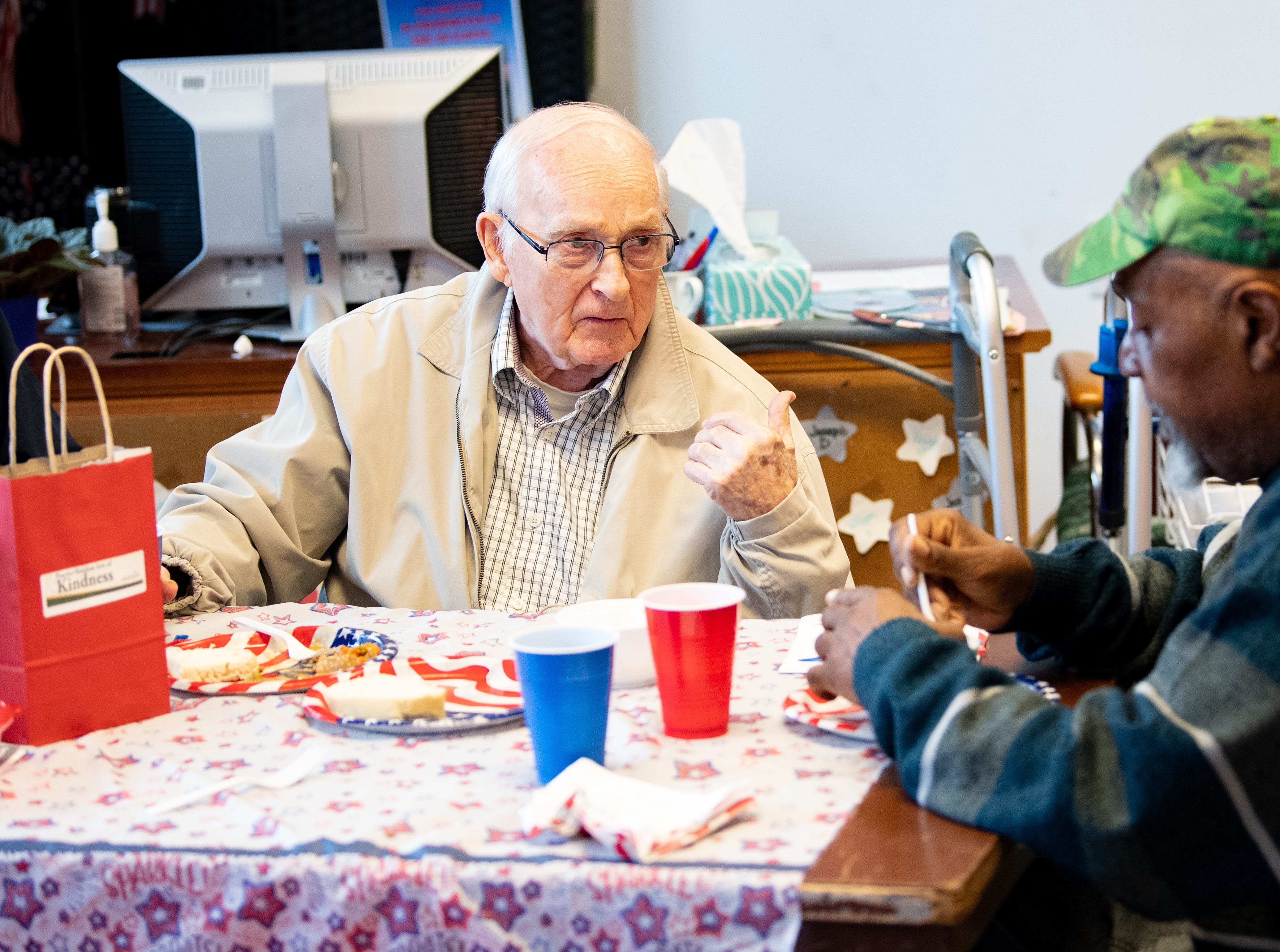During World War II, Allen Ziegler, left, drove tanks. John Wilbert Johnson served in the Army from 1969 to 1973. The two, who live at Country Meadows of York, talked during a lunch that brought veterans together with homeless York veterans.
